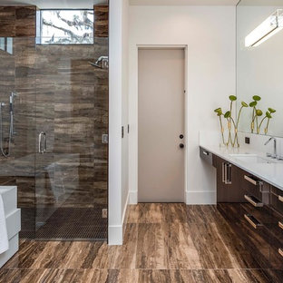 Inspiration for a large contemporary master porcelain tile and brown tile porcelain floor and brown floor bathroom remodel in Orlando with an undermount sink, flat-panel cabinets, dark wood cabinets, white walls, a hinged shower door and white countertops