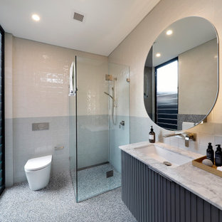 Bathroom - mid-sized contemporary 3/4 multicolored tile terrazzo floor, single-sink and coffered ceiling bathroom idea in Sydney with furniture-like cabinets, gray cabinets, an undermount tub, multicolored walls, an undermount sink, marble countertops, white countertops and a floating vanity