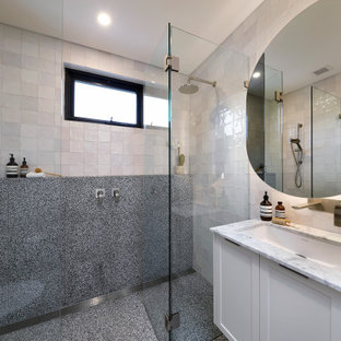 Photo of a mid-sized contemporary 3/4 bathroom in Sydney with shaker cabinets, white cabinets, a double shower, a wall-mount toilet, multi-coloured tile, porcelain tile, marble floors, an undermount sink, marble benchtops, a hinged shower door, white benchtops, a single vanity and a floating vanity.