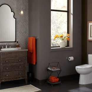 Mid-sized transitional master bathroom photo in Other with furniture-like cabinets, distressed cabinets, a one-piece toilet, gray walls and a drop-in sink