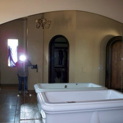 """mirrors and showers - 1/4"""" mirrors to radius pattern. Left mirror panel has holes for tub faucet control knobs"""