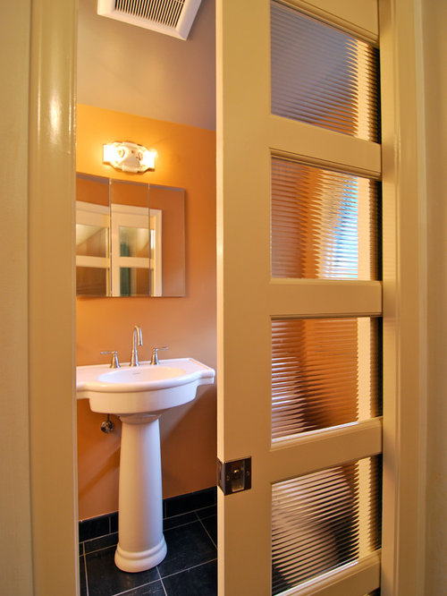 Foto e Idee per Bagni - bagno moderno con pareti arancioni