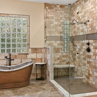 Bathroom - large mediterranean master gray floor and brick wall bathroom idea in Other with beige walls and a hinged shower door