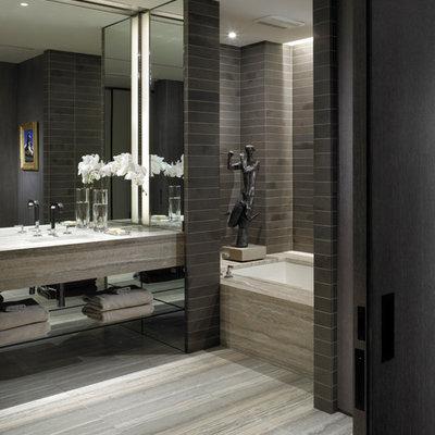 Minimalist gray tile bathroom photo in New York with black walls