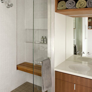 Inspiration for a modern bathroom in San Francisco with an undermount sink, flat-panel cabinets, medium wood cabinets, an alcove shower, white tile, a niche and a shower seat.