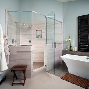 Example of a large trendy master beige tile and stone tile ceramic tile and beige floor bathroom design in San Diego with blue walls, furniture-like cabinets, dark wood cabinets, a hinged shower door, a two-piece toilet, a vessel sink and quartz countertops