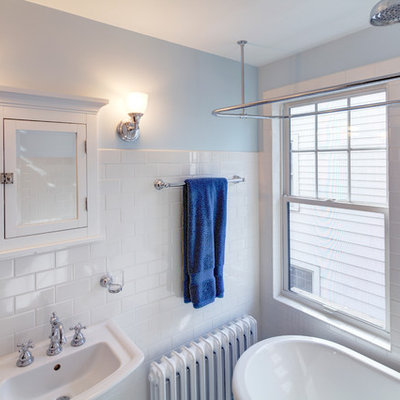 Example of a small arts and crafts white tile and subway tile bathroom design in Other with a pedestal sink, a two-piece toilet and blue walls