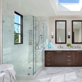 Freestanding bathtub - traditional freestanding bathtub idea in San Francisco with dark wood cabinets