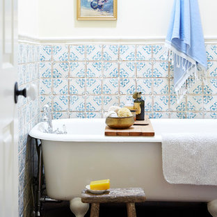 Example of a mid-sized eclectic white tile and terra-cotta tile terra-cotta floor and brown floor claw-foot bathtub design in San Francisco with open cabinets, light wood cabinets, marble countertops and white countertops