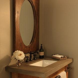 Ispirazione per una piccola stanza da bagno industriale con consolle stile comò, ante in legno chiaro, top in cemento, pareti grigie e pavimento in marmo