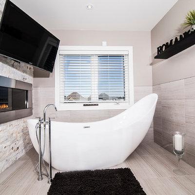 Example of a trendy freestanding bathtub design in Toronto
