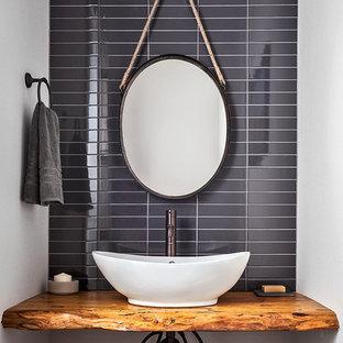Ispirazione per una stanza da bagno moderna con nessun'anta, ante con finitura invecchiata, piastrelle nere, piastrelle in ceramica, pareti bianche, lavabo a bacinella, top in legno e top marrone