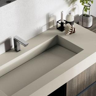 Immagine di una grande stanza da bagno padronale minimalista con ante lisce, doccia a filo pavimento, pareti grigie, lavabo integrato, top beige, un lavabo e mobile bagno sospeso