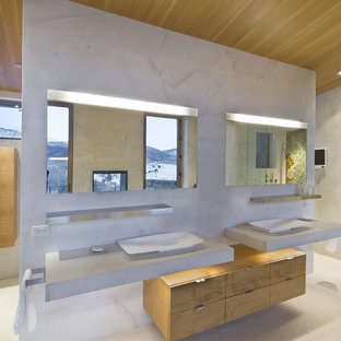 Design ideas for a modern bathroom in Denver with a vessel sink, flat-panel cabinets, concrete benchtops and light wood cabinets.