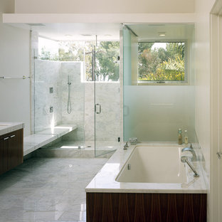 Bathroom - modern white tile bathroom idea in Los Angeles with an undermount sink, flat-panel cabinets, dark wood cabinets and an undermount tub