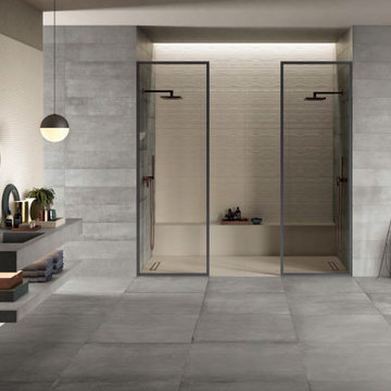 Modern bathroom and shower with stone look porcelain tile walls and floors