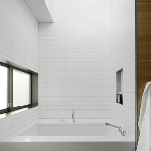 Inspiration for a modern bathroom in San Francisco with a submerged bath and white tiles.