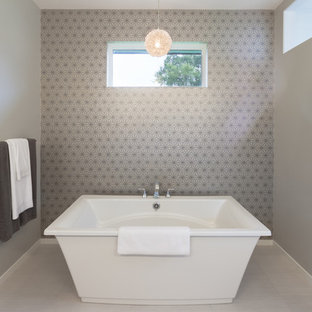 Example of a transitional freestanding bathtub design in Minneapolis with gray walls