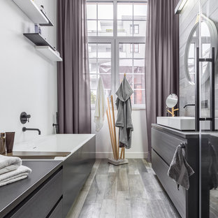 Design ideas for a contemporary shower room bathroom with flat-panel cabinets, grey cabinets, a freestanding bath, white walls, a vessel sink, grey floors and grey worktops.