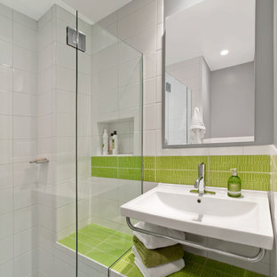 Example of a minimalist green tile bathroom design in New York with a wall-mount sink