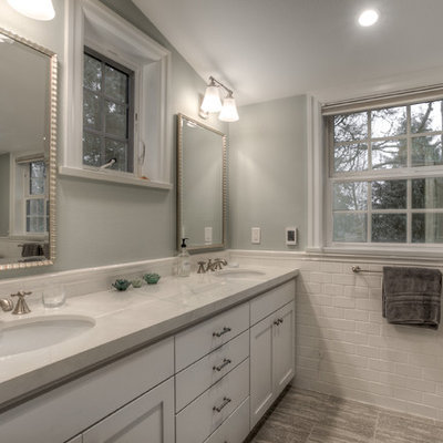 Inspiration for a large timeless master white tile and subway tile marble floor alcove shower remodel in Seattle with recessed-panel cabinets, white cabinets, a one-piece toilet, gray walls, an undermount sink and granite countertops