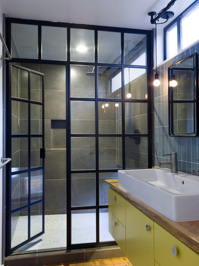 Industrial Bathroom by Robert Nebolon Architects