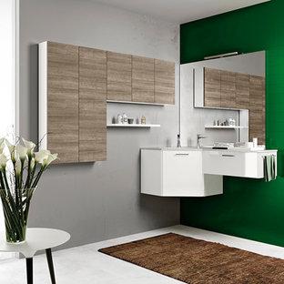 Новые идеи обустройства дома: маленькая ванная комната в стиле модернизм с монолитной раковиной, плоскими фасадами, фасадами цвета дерева среднего тона, столешницей из ламината, угловой ванной, угловым душем, унитазом-моноблоком, белой плиткой, керамической плиткой, зелеными стенами, бетонным полом и душевой кабиной