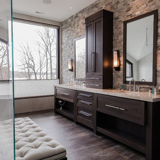 Bathroom - transitional master brown tile and stone tile dark wood floor and brown floor bathroom idea in Other with shaker cabinets, dark wood cabinets, beige walls, an undermount sink and beige countertops
