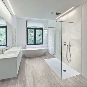Modern bathroom with light wood look porcelain tiled floor and stone look shower