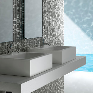 Expansive modern master bathroom in Miami with a vessel sink, recycled glass benchtops, an open shower, gray tile, glass tile and grey walls.