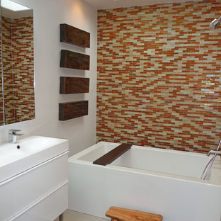 Example of a minimalist multicolored tile and mosaic tile bathroom design in San Diego with flat-panel cabinets and white cabinets