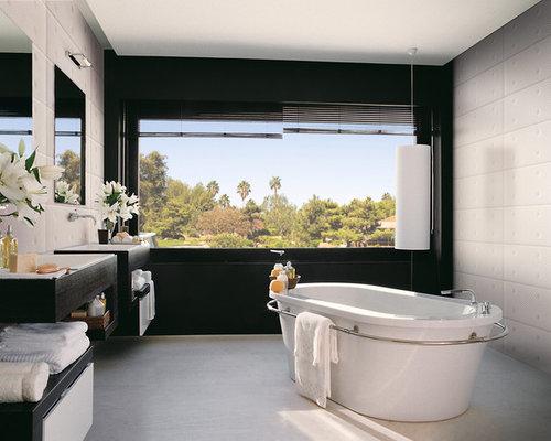 modern freestanding bathtub idea in orange county with black walls