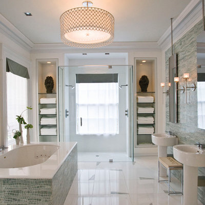 Example of a trendy double shower design in Orange County with a pedestal sink, open cabinets and an undermount tub