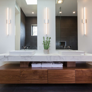 Example of a mid-sized minimalist master gray tile and ceramic tile porcelain tile and gray floor bathroom design in Los Angeles with flat-panel cabinets, dark wood cabinets, a two-piece toilet, gray walls, a vessel sink, marble countertops and white countertops