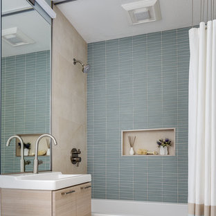 Example of a small trendy green tile and ceramic tile ceramic tile and white floor bathroom design in San Francisco with flat-panel cabinets, beige cabinets, white walls, a wall-mount sink, solid surface countertops, a one-piece toilet and white countertops