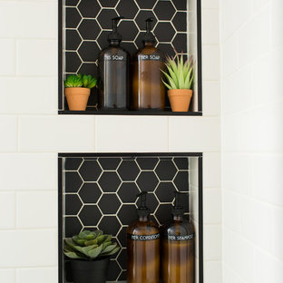 Bathroom - large eclectic master white tile and subway tile cement tile floor and white floor bathroom idea in Raleigh with shaker cabinets, medium tone wood cabinets, a two-piece toilet, white walls, an undermount sink, limestone countertops, a hinged shower door and white countertops