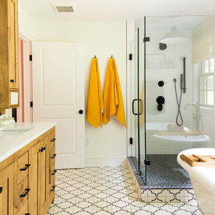 Design ideas for a large transitional master bathroom in Raleigh with shaker cabinets, medium wood cabinets, a claw-foot tub, an open shower, a two-piece toilet, white tile, white walls, cement tiles, an undermount sink, limestone benchtops, white floor, a hinged shower door and white benchtops.