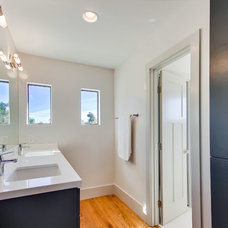 Modern Bathroom by Green Button Homes LLC