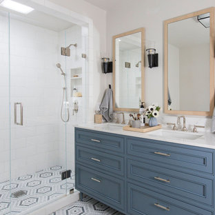 Large transitional master white tile and subway tile mosaic tile floor, multicolored floor and double-sink alcove shower photo in San Francisco with furniture-like cabinets, blue cabinets, an undermount sink, quartz countertops, a hinged shower door, white countertops and a freestanding vanity