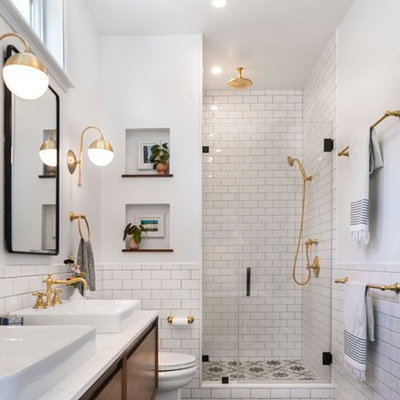 Example of a mid-sized transitional master white tile and ceramic tile mosaic tile floor and black floor alcove shower design in Los Angeles with flat-panel cabinets, white walls, a vessel sink, quartz countertops, a hinged shower door, white countertops and medium tone wood cabinets