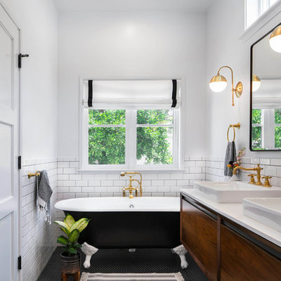 Mid-sized transitional master white tile and ceramic tile mosaic tile floor and black floor claw-foot bathtub photo in Los Angeles with flat-panel cabinets, white walls, a vessel sink, quartz countertops, white countertops and medium tone wood cabinets