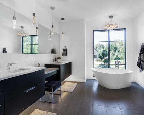 inspiration for a contemporary master gray floor freestanding bathtub remodel in grand rapids with flat