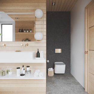 Photo of a large modern bathroom in Other with a wall mounted toilet, grey tiles, slate tiles, white walls, slate flooring, a trough sink, engineered stone worktops, grey floors, an open shower and white worktops.
