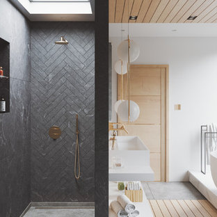 Large contemporary bathroom with a freestanding bath, white walls, a trough sink, grey floors, an open shower, white worktops, a wall mounted toilet, grey tiles, slate tiles and engineered stone worktops.