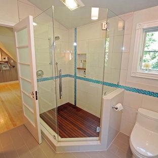 Transitional corner shower photo in Milwaukee