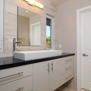 Inspiration for a modern beige tile bathroom remodel in Sacramento with a vessel sink, flat-panel cabinets and white cabinets
