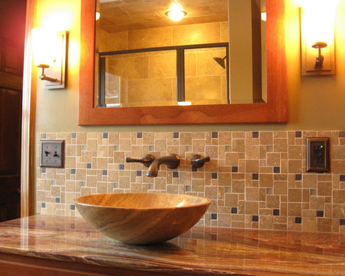 inspiration for a craftsman alcove shower remodel in st louis with a vessel sink and brown