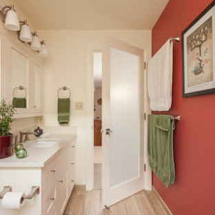 Inspiration for a small craftsman white tile and porcelain tile ceramic floor and beige floor doorless shower remodel in Portland with white cabinets, a one-piece toilet, red walls, an integrated sink, granite countertops and a hinged shower door