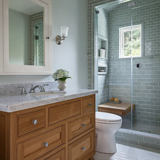 Inspiration for a mid-sized arts and crafts 3/4 bathroom in San Francisco with shaker cabinets, medium wood cabinets, an alcove shower, a two-piece toilet, green tile, subway tile, green walls, porcelain floors, an undermount sink, marble benchtops, white floor and a hinged shower door.