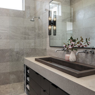 Photo of a mid-sized modern master bathroom in Miami with flat-panel cabinets, black cabinets, an alcove shower, gray tile, a trough sink, grey floor, an open shower, grey benchtops and grey walls.